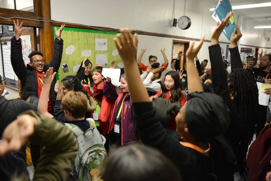 New York City students who are part of IntegrateNYC, a youth activist group that pushes for policies that would better integrate city schools, celebrate the end of a meeting in December, held at Essex Street Academy in Manhattan.