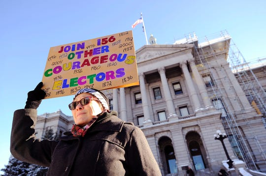 Amber Dahlin urged Colorado electors to vote their conscience outside the state Capitol in Denver on Dec. 19, 2016, as the 538 members of the Electoral College confirmed Donald Trump's election.