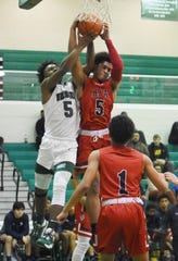 Peabody's Thomas Miles (left) battles with Lafayette Christian's BJ Francis for a rebound Tuesday, Jan. 7, 2020. Peabody won 86-66.