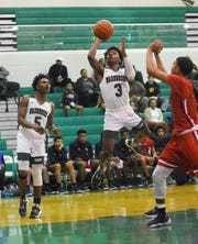 Peabody senior Melvion Flanagan (3) scores on a layup against Lafayette Christian Tuesday, Jan. 7, 2020. Flanagan is the 2020 All-Cenla Boys Basketball MVP.