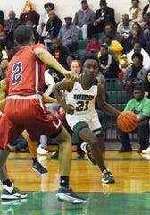 Peabody's Kaijalon Smith (21) drives for two against Lafayette Christian Tuesday, Jan. 7, 2020. Peabody won 86-66.