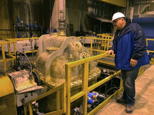 Bill Graffin, spokesman for the Milwaukee Metropolitan Sewerage District, looks at pumps located 300 feet underground at the Jones Island Water Reclamation Facility on Nov. 15, 2019. The pumps send water stored in the district's Deep Tunnel into the plant for treatment.