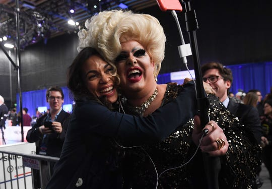 Actress Rosario Dawson, girlfriend of New Jersey Senator Cory Booker, poses with drag queen Pissi Myles in the Spin Room after the fifth Democratic primary debate of the 2020 presidential campaign season co-hosted by MSNBC and The Washington Post at Tyler Perry Studios in Atlanta, Georgia on Nov. 20, 2019.