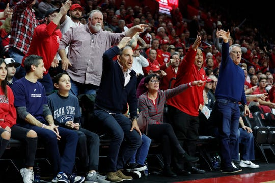 Spectators react to a call by a referee during the first quarter of an NCAA college basketball game between Rutgers and Penn State