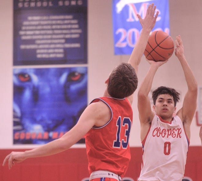 Cooper guard Josh Henry (0) shoots over Graham's Bryce Bozeman in the first quarter. Henry scored a game-high 22 points in the Cougars' 64-54 win over the Steers on Tuesday, Jan. 7, 2020, at Cougar Gym.