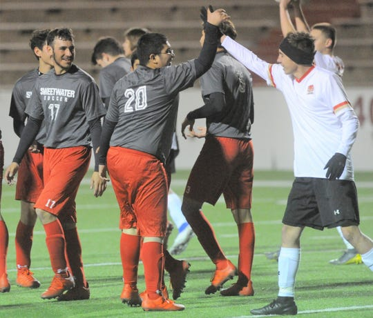 Sweetwater senior Nathan Garcia (20) high-fives a Lubbock Coronado player after scoring a goal Tuesday at the Mustang Bowl. It was the first goal in program history for Sweetwater.