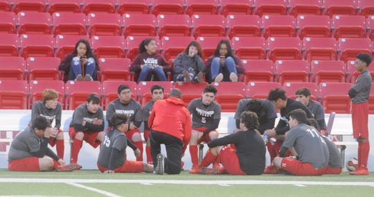 Sweetwater coach John Reddic, center, talks to his players during halftime of their inaugural game against Lubbock Coronado on Tuesday, Jan. 7, 2020, at the Mustang Bowl.