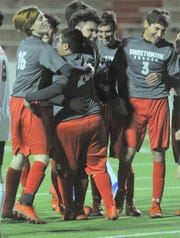 Sweetwater teammates celebrate with Nathan Garcia (20) after he scored a goal against Lubbock Coronado on Tuesday at the Mustang Bowl.