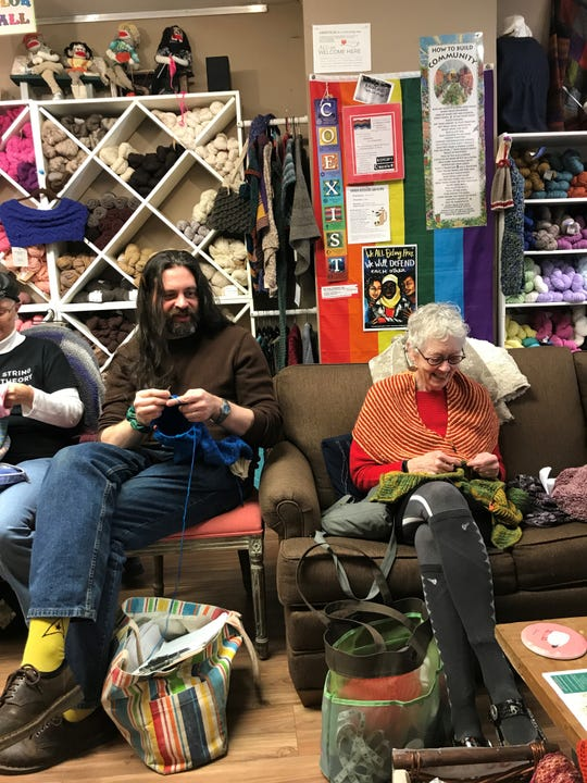 Rik Schell, left, and Dorothy Foltz-Gray at a Purl's Yarn Emporium knitting circle.