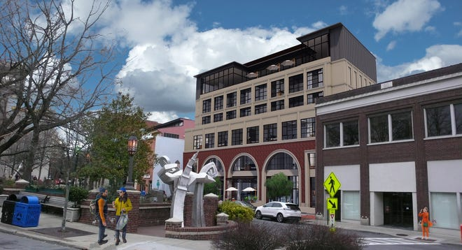 A new developer has tweaked the design of the proposed 60-room Parisian Hotel on Patton Avenue, the taller building in this architectural rendering. The plan now calls for a smaller footprint for the building and a 20-foot deep courtyard on the ground level.