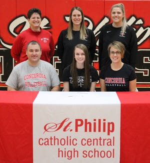 St. Philip's Abby Austin commits to play at Concordia University. She is joined by family and coaches.