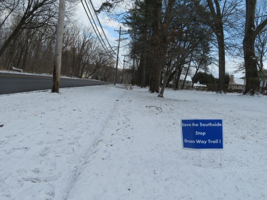 Signs in opposition to the Department of Transportation plan to extend the Route 434 Greenway can be seen along Vestal Avenue.