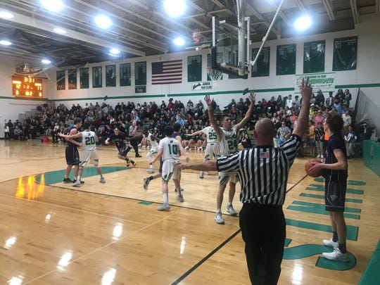 Veteran official Rick Barker is all over the action from Seton Catholic Central's 65-44 win over Norwich on Jan. 7, 2020.