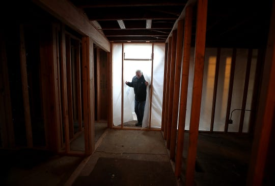 Tom Haggar enters a space that will soon house a restaurant in the old Virginia Mason clinic building, on Wednesday, Jan. 8, 2020.