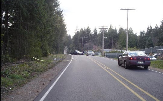 The scene during the afternoon of April 5, 2006, in the 3300 block of SE Bielmeier Road, South Kitsap, when a deceased infant girl was discovered abandoned along the roadside.