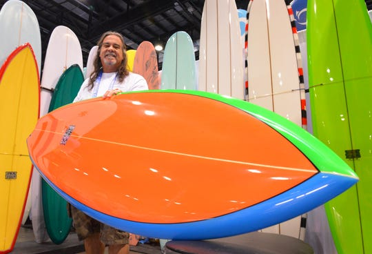 Rockledge-based surfboard builder and shaper Ricky Carroll shows his new line of Ricky'ss Retro boards. The 2020 Surf Expo is the largest and longest-running board sports and beach/resort lifestyle trade show in the world, with over a thousand exhibitors. It is taking place January 8-12 at the Orange County Convention Center in Orlando.