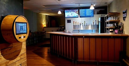 1803 Brewery & Taproom features a digital menu of draft offerings and TouchTunes for music.