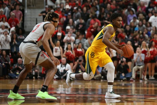 Jan 7, 2020; Lubbock, Texas, USA;  Baylor Bears guard Davion Mitchell (45) dribbles the ball around Texas Tech Red Raiders guard Jahmi'us Ramsey (3) in the first half at United Supermarkets Arena. Mandatory Credit: Michael C. Johnson-USA TODAY Sports
