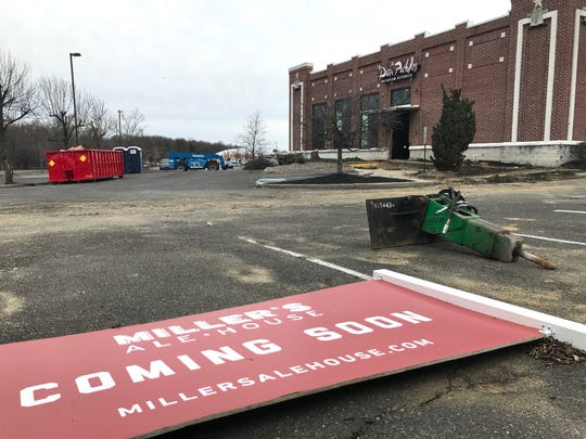 A sign that announces plans for a Miller's Ale House lies outside the gutted shell of a former Don Pablo's restaurant in Deptford.