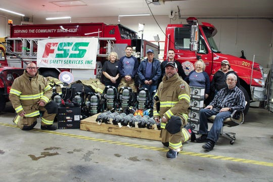 Members of the Jefferson Township Fire and Rescue take a portrait with the new equipment that they received that was made possible by the Gary Sinise Foundation's First Responders Outreach program. The new gear included eight sets of fire gear along with eight sets of  MSA G1 Self-Contained Breathing Apparatuses (SCBA).