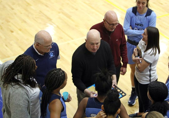 Mount Notre Dame head coach Scott Rogers draws out a play during a time out in the girls basketball game at St. Ursula Jan. 7, 2020.