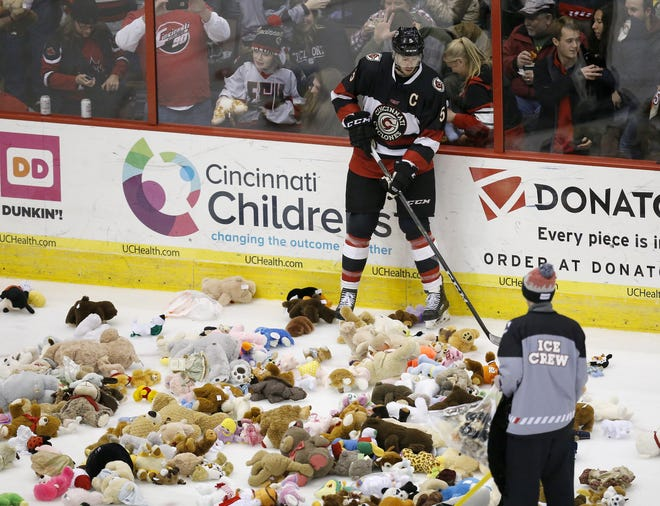 Fans threw what the Cyclones said were more than 4,000 teddy bears on the ice during the eighth annual Teddy Bear Toss Jan. 6 2018. The bears go to the Cincinnati Police Department.