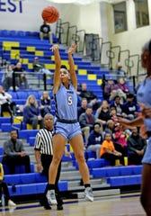 Mount Notre Dame forward Laila Phelia knocks this three-point shot down in the basketball game at Saint Ursula Bulldogs Jan. 7, 2020.