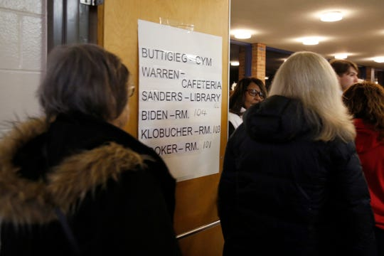 Voters break off into separate rooms based on their preferred candidate during a caucus to elect democratic convention delegates at Winton Woods Intermediate School in Cincinnati on Tuesday, Jan. 7, 2020. Democrats from the 1st Congressional District cast votes for delegates they hope to represent them in the upcoming election.