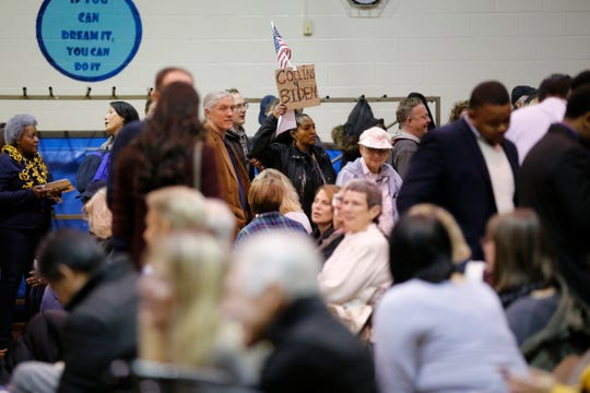Hundreds of voters arrive to cast their ballots during a caucus to elect democratic convention delegates at Winton Woods Intermediate School in Cincinnati on Tuesday, Jan. 7, 2020. Democrats from the 1st Congressional District cast votes for delegates they hope to represent them in the upcoming election.