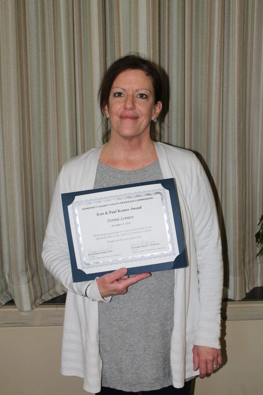 Donna Lenoxwith her Jean & Paul Krauss Award certificate.
