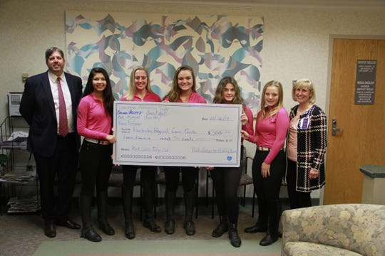 The Hunterdon County 4-H Pink Ladies Performance Riding Team recently donated $3,000 to support Hunterdon Regional Cancer Center. The girls sold bracelets and collected money during their horse shows. The group is part of the Round Valley Riders 4-H Club. (Left to right)Phil Beekman, senior vice president, Hunterdon Healthcare Foundation;Eva Zajac, Jessie Ditzel, Emma Bacon, Mackenzie Snyder, Lydia Kilinski and Barbara Tofani, assistant vice president, Outpatient and Ambulatory Services, Hunterdon Healthcare System.