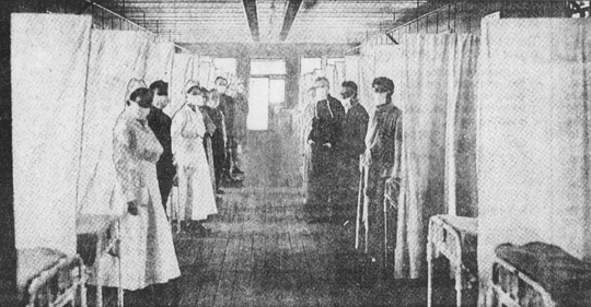 A postcard from the era shows a ward of the hospital at Camp Dodge during the influenza epidemic.