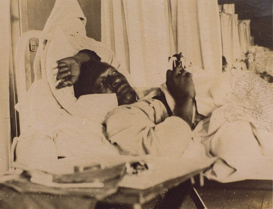 A soldier rests in bed during the influenza epidemic that struck Camp Dodge on Oct. 1, 1918. Within a week, 6,000 soldiers were ill, and the camp hospital was overwhelmed. The Army later put the death toll at 702.