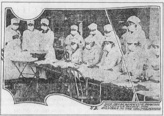 """This photo was in The Evening Tribune during the flu epidemic in 1918. The caption below the photo reads: """"Red Cross workers making influenza masks for soldiers in the cantonments."""""""