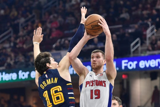 Detroit Pistons guard Sviatoslav Mykhailiuk shoots against Cleveland Cavaliers forward Cedi Osman in the second quarter at Rocket Mortgage FieldHouse, Jan. 7, 2020, in Cleveland.