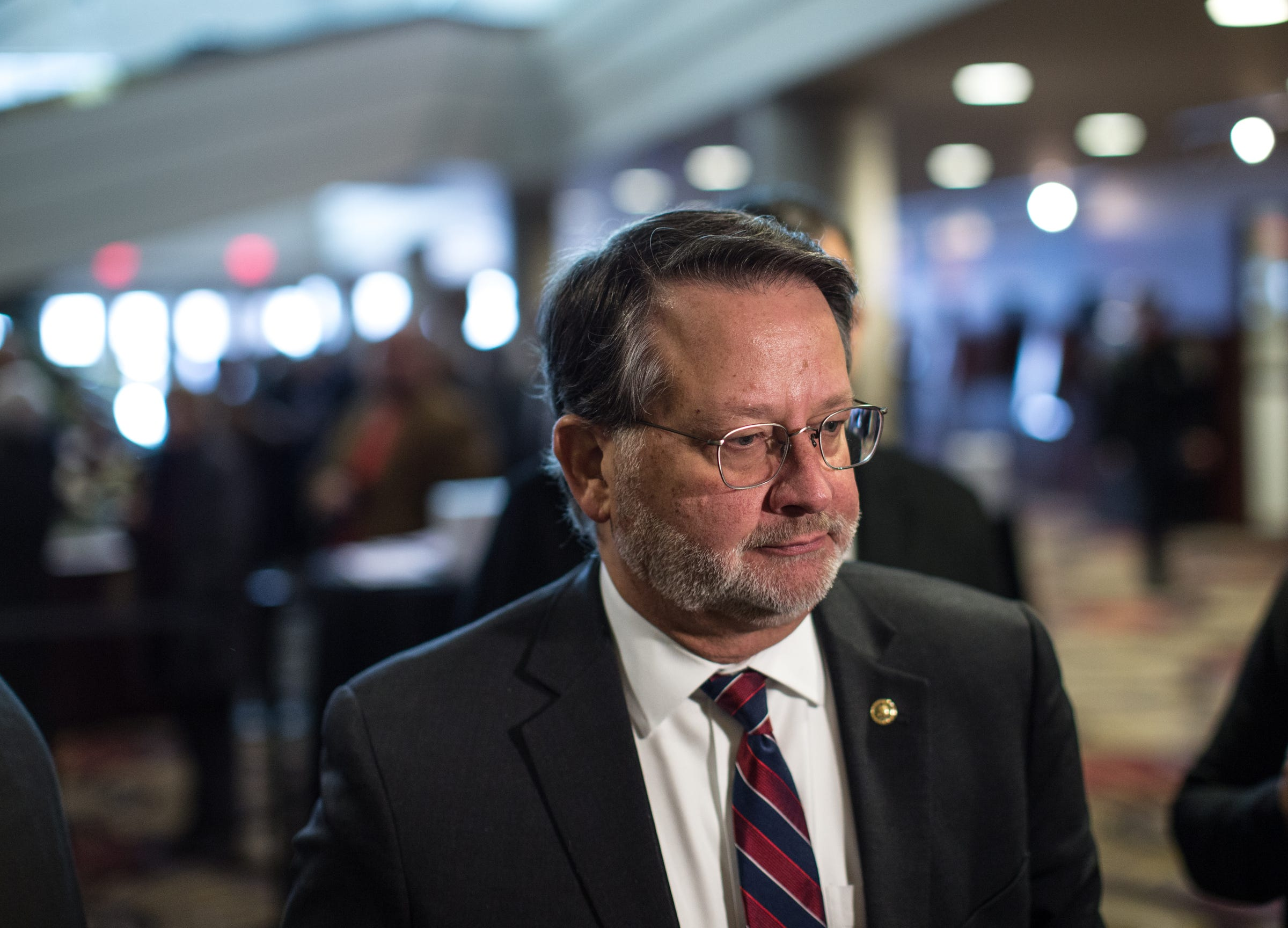 U.S. Senator Gary Peters talks with media during visitation of former US Representative John D. Dingell at the Ford Community and Performing Arts Center in Dearborn on Monday, February 11, 2019.