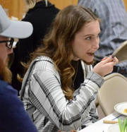 Kaleigh Maviglia, of Toledo, tries muskrat for the first time.