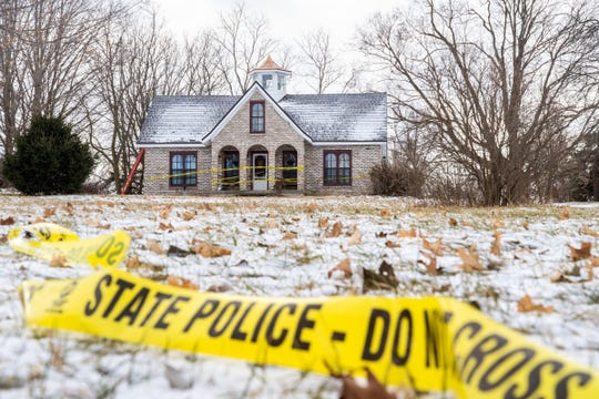 Police tape remains around the home of Mark Latunski on Tyrell Rd. In Morrice on Wednesday, Jan. 8, 2020. Latunski is accused of killing and eating parts of his Grindr date, Kevin Bacon of Swartz Creek, at Latunski's home.