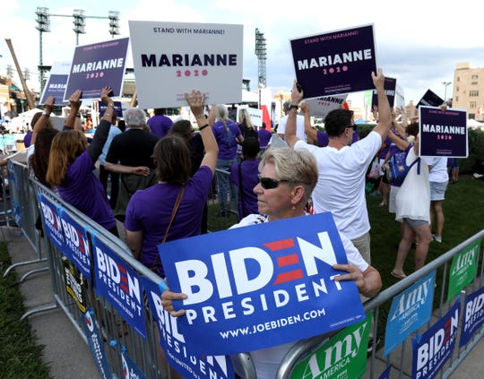 Lynne Parsons, 65 of Oak Park is surrounded by Marianne Williamson supporters yelling their support for her before the Democratic Presidential debate at the Fox Theatre in Detroit, Michigan on Tuesday, July 30, 2019