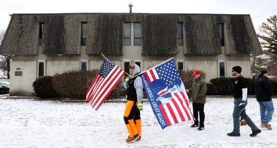 Eight members of The Proud Boys walk in front of the Iraqi Consulate  on Wednesday, January 8, 2020 in Southfield, Michigan. They gathered for a second day of protesting the opening of the building for people to come in for condolences in the death of Iranian General Qassem Soleimani and Iraqi's killed in an airstrike by American drones last Friday.