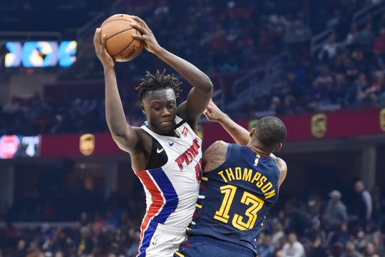 Detroit Pistons forward Sekou Doumbouya (left) drives against Cleveland Cavaliers center Tristan Thompson (13) in the second quarter at Rocket Mortgage FieldHouse on Tuesday, Jan. 7, 2020, in Cleveland.