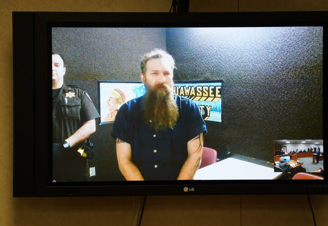 Mark Latunski makes a video appearance at the 66th District Court in Corunna on Wednesday, January 8, 2020 for his probable cause hearing. Latunski is accused of killing and eating parts of his Grindr date, Kevin Bacon of Swartz Creek,  at Latunski's home in Bennington Township.