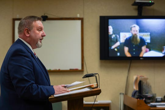 Attorney Doug Corwin speaks on behalf of his client Mark Latunski as he makes a video appearance at the 66th District Court in Corunna on Wednesday, Jan. 8, 2020, for his probable cause hearing.