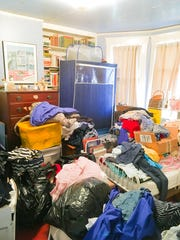 A photo of Yvonne and Kent Shafer's junk room before a makeover by the Michigan chapter of the National Association of Productivity and Organizing Professionals.