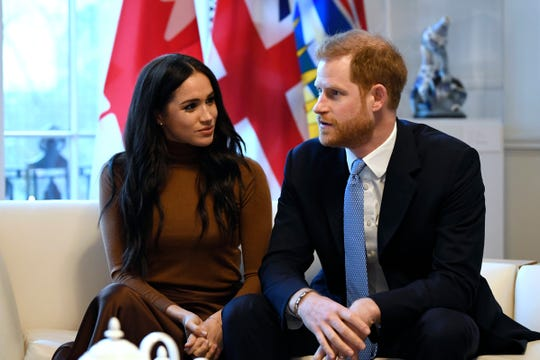 Britain's Prince Harry and Meghan, Duchess of Sussex, during their visit to Canada House in thanks for the warm Canadian hospitality and support they received during their recent stay in Canada, in London, Tuesday.