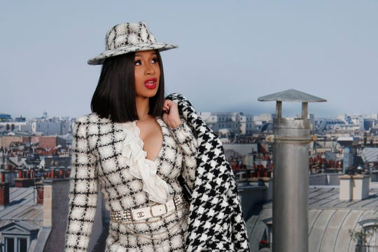Singer Cardi B poses for photographers as she arrives for the Chanel Ready To Wear Spring-Summer 2020 collection in Paris, France. Cardi B's announcement in a tweet on Jan. 3, 2020, that she wants to seek Nigerian citizenship has set off a Twitter feud between her West African fans in friendly rivals Nigeria and Ghana.