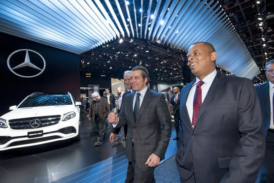 John Bozzella, center, with then-U.S. Transportation Secretary Anthony Foxx,  at the North American International Auto Show in Detroit in January 2016. Bozzella will lead a new auto lobbying group.