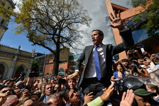 Opposition leader Juan Guaido argues for National Guards to let him and all opposition lawmakers into the National Assembly, saying he will not enter unless all of them are allowed entry, outside the legislature in Caracas, Venezuela, Tuesday, Jan. 7, 2020.