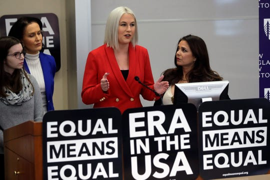 Vice President of Equal Means Equal Natalie White, center right, faces reporters as plaintiff Katherine Weitbrecht, left, legal counsel Wendy Murphy, second from left, and President of the organization Kamala Lopez, right, look on during a news conference, Tuesday, Jan. 7, 2020, in Boston, held to address issues about a lawsuit filed Tuesday in U.S. District Court, in Boston.)