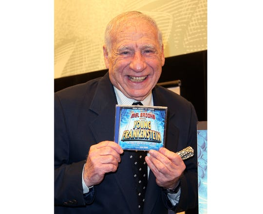 """Mel Brooks poses with the CD of the Broadway performance sound track of """"Young Frankenstein"""" in New York in 2008."""